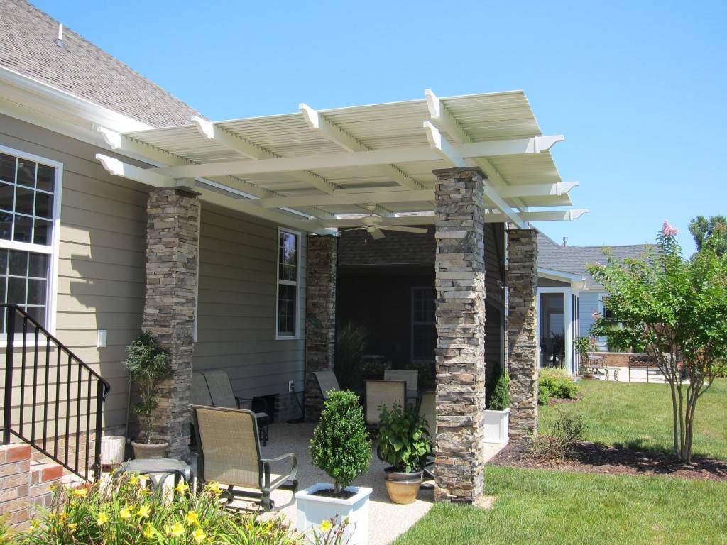 After the Louvered Roof installation, the homeowner has a beautiful, shaded, weather proof outdoor space offering privacy and comfort