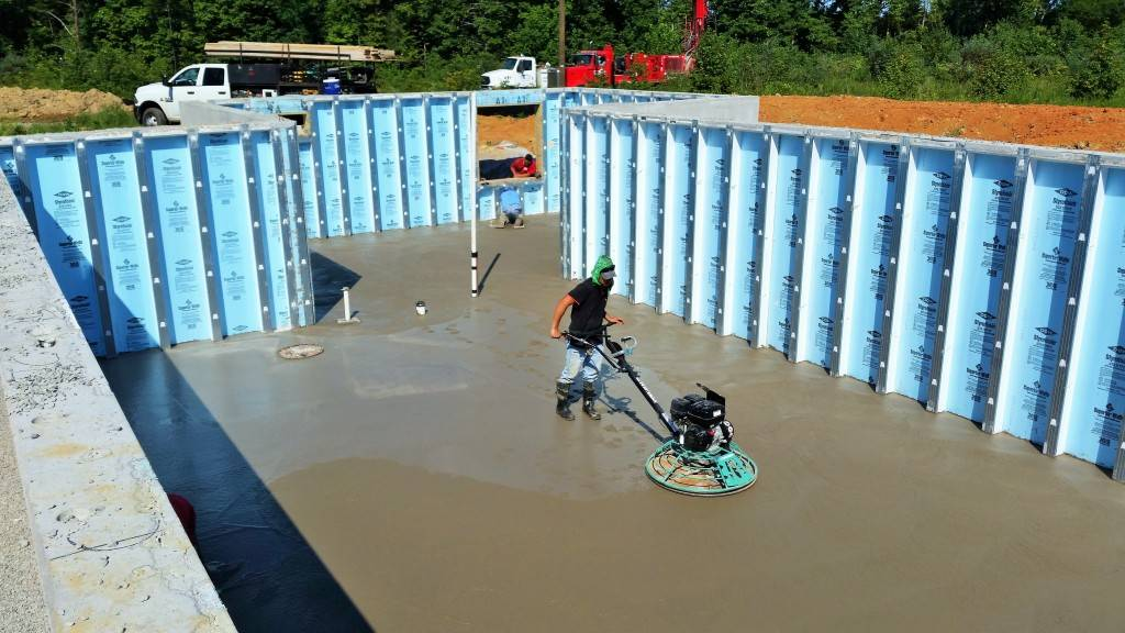 Once the Superior Walls and under the slab plumbing and inspections are complete. the slab is poured and finished.