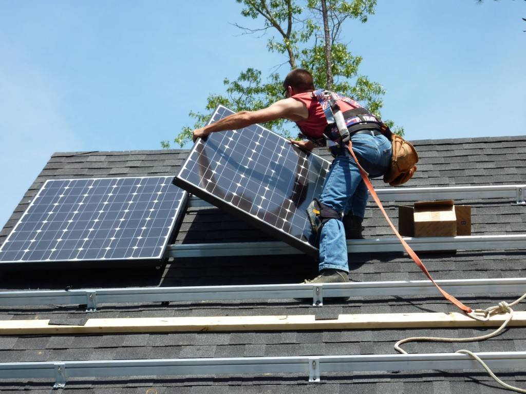 ODI's installer places Solar panels on roof of Net zero energy home in Montpelier VA